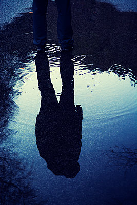Reflection of a mysterious male in a puddle  - p794m2057184 by Mohamad Itani