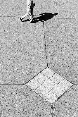 Walking man - p1245m1069384 by Catherine Minala