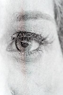 Newspaper, Woman's eye - p265m2071271 by Oote Boe