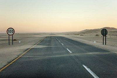 Highway road in desert.  - p1403m1482645 by Hoberman