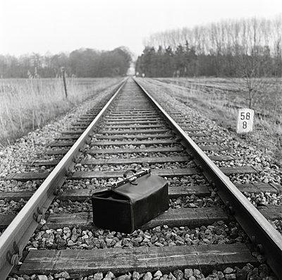 A bag on train tracks - p301m975969f by Constantin Falk