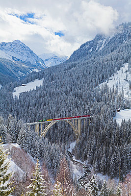 Switzerland, Rhaetian railway passing through Langwieser Viaduct bridge - p300m981464f by Werner Dieterich