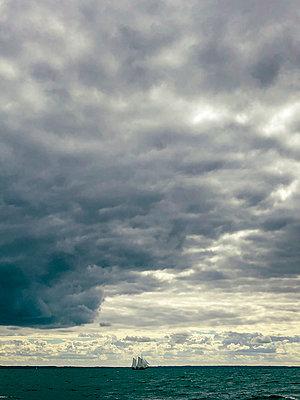 Sailing ship on the horizon - p382m2283997 by Anna Matzen