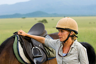 Nicola Young, horse riding guide for both Ol Donyo Wuas and Ride Africa - p6521169 by John Warburton-Lee