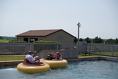 Father and Son in Bumper Boats - p1169m1124049 by Tytia Habing