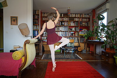 A small girl practices dance ballet at home - p1610m2263104 by myriam tirler