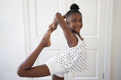 Dark-skinned girl in polka-dotted skirt - p1640m2254588 by Holly & John