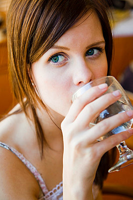 Girl drinking - p4264134f by Tuomas Marttila