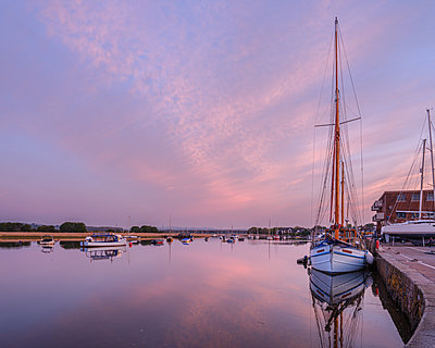 Turf Ferry and other boats moored on a mirror calm River Exe at Topsham, Devon, England, United Kingdom - p871m2111487 by Baxter Bradford