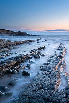 Rocky ledges in twilight - p871m861629 by Adam Burton