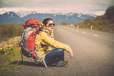 Beautiful Backpacker Tourist in Iceland - p1166m2201008 by Cavan Images