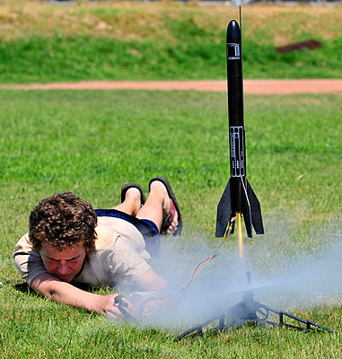 A boy launches a model rocket. - p343m1033309 by Kevin Steele