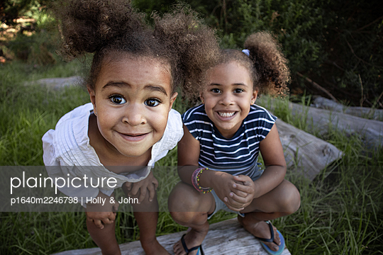 Two curly-haired girls in the countryside - p1640m2246798 by Holly & John