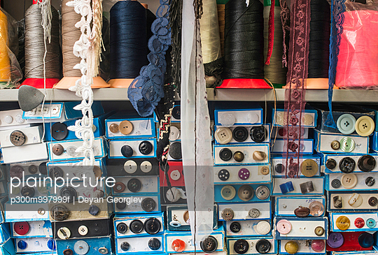 Lace and cardboard boxes with buttons in a shop