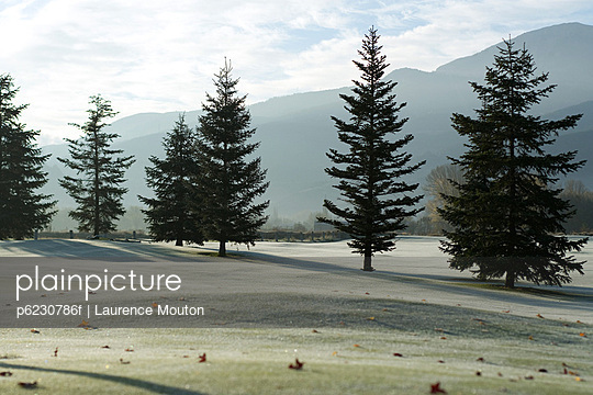 Frost-covered golf course in mountains - p6230786f by Laurence Mouton