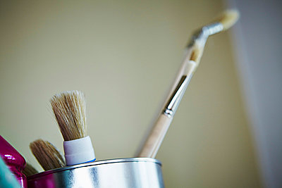 Home improvement, paintbrushes in a bucket, Munich, Bavaria, Germany - p1026m857208f by Dario Secen