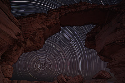 Africa, Chad, View of star trail and rock formation at Ennedi range - p300m879203 by Martin Rietze