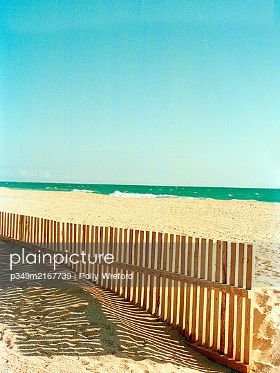Shadows of a wooden seabreaker on sandy Spanish beach - p349m2167739 by Polly Wreford