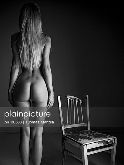 Nude woman with chair - p4130533 by Tuomas Marttila