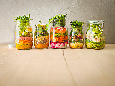 Row of five preserving jars with various salads - p300m1459903 by Kai Schwabe