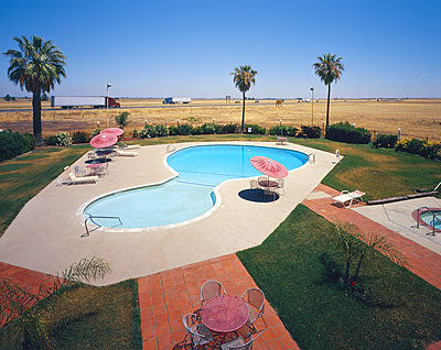 Motel swimming pool near freeway - p555m1303349 by Tom Paiva Photography