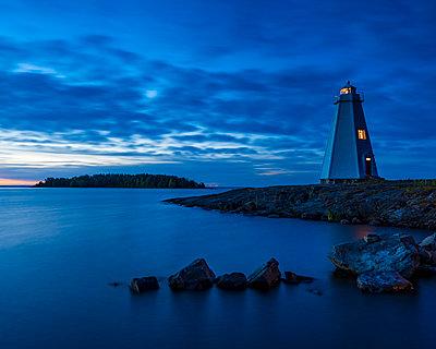 Lighthouse at dusk - p312m2119860 by Johner
