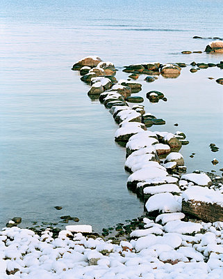 Stones in the water - p312m696055 by Bruno Ehrs