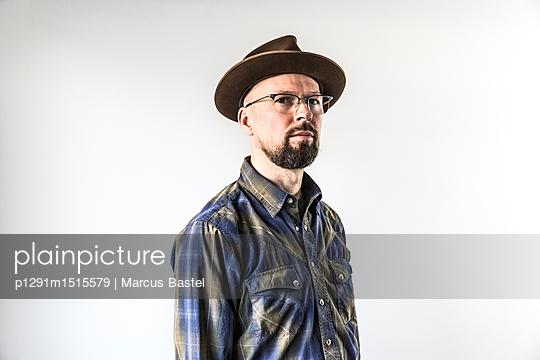 Portrait of bearded man - p1291m1515579 by Marcus Bastel