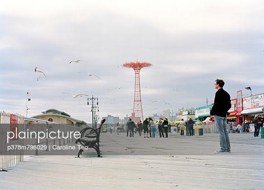 Man on boardwalk - p378m796029 by Caroline Teo