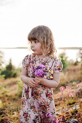 Girl picking flowers - p312m2091886 by Karolina  Ehrenpil