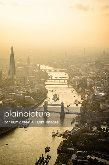 Aerial view of London cityscape and river, England,London, England - p1100m2084494 by Mint Images