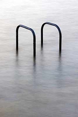 Hand rails at a tidal swimming pool in St Peters Port, Guernsey, The Channel Islands, UK - p8551086 by David Clapp