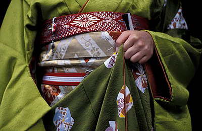Midsection of apprentice Geisha - Maiko - p6440981 by Alex lay