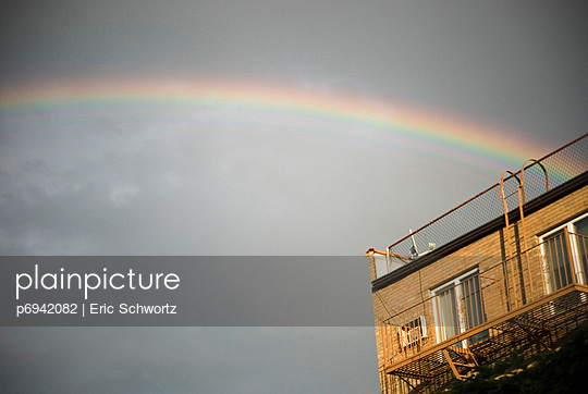 Rainbow and Building - p6942082 by Eric Schwortz