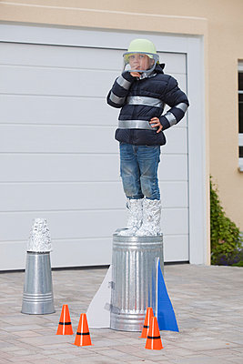 Boy standing on selfconstructed rocket - p42912333f by Judith Haeusler