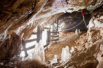 A rigged gated winter alberta cave mouth; canmore alberta canada - p442m700118f by Corey Hochachka