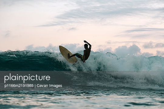 Surfer on a wave, Lombok, Indonesia - p1166m2191985 by Cavan Images