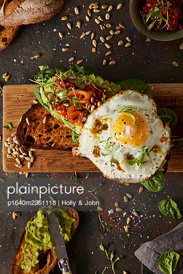 Fried egg on toasted bread - p1640m2261118 by Holly & John