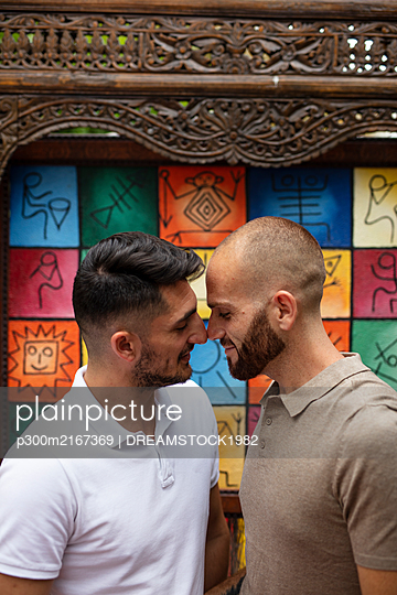 Gay couple rubbing noses - p300m2167369 by DREAMSTOCK1982