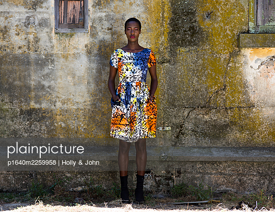 African woman in colourful dress - p1640m2259958 by Holly & John