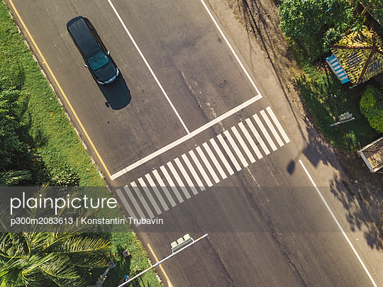 Indonesia, Bali, Sanur, Aerial view of car at zebra crossing on the road - p300m2083613 by Konstantin Trubavin