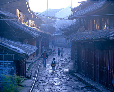 Lijiang old town, Yunnan Province - view down cobbled street - p8550270 by Marcel Malherbe