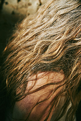 Close-up of a long-haired woman in an abandoned house - p1540m2141268 by Marie Tercafs