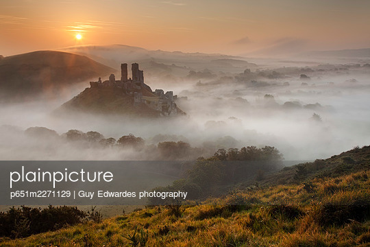 Corfe Castle in the mist, Dorset, England, - p651m2271129 by Guy Edwardes photography