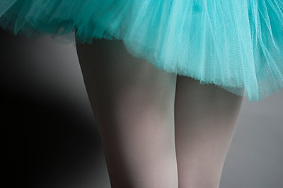 Female ballet dancer, midsection in turquoise tutu and white tights. - p1433m1531939 by Wolf Kettler