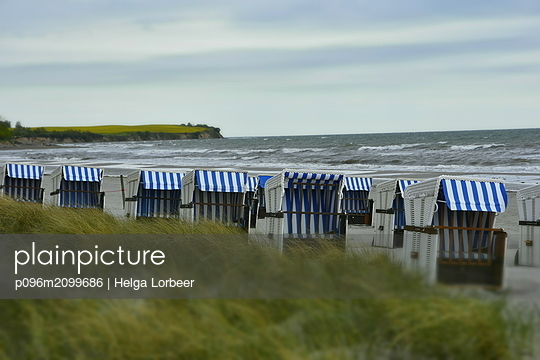 Beach chairs on the sea - p096m2099686 by Helga Lorbeer