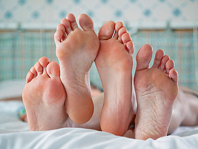 Feets in bed - p4265241f by Tuomas Marttila