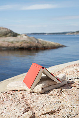 A book lying on a rock - p4641255 by Elektrons 08