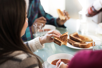 Cropped image of friends having breakfast at home - p1166m1098308f by Cavan Images