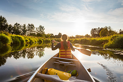 Canoeing in Still Creek, Burnaby,  British Columbia. - p1166m2202115 by Christopher Kimmel / Alpine Edge Photography